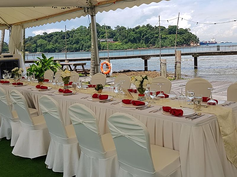 dining table set up with seaview