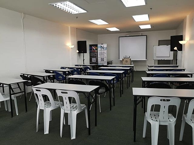 penang event space with classroom seating and projector screen