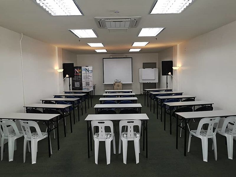 function room for seminar with projector screen and speakers