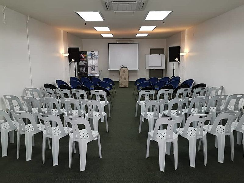 medium size seminar room with projector screen and speakers in penang