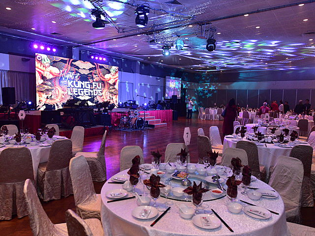 ballroom for music event with round table and colourful lighting