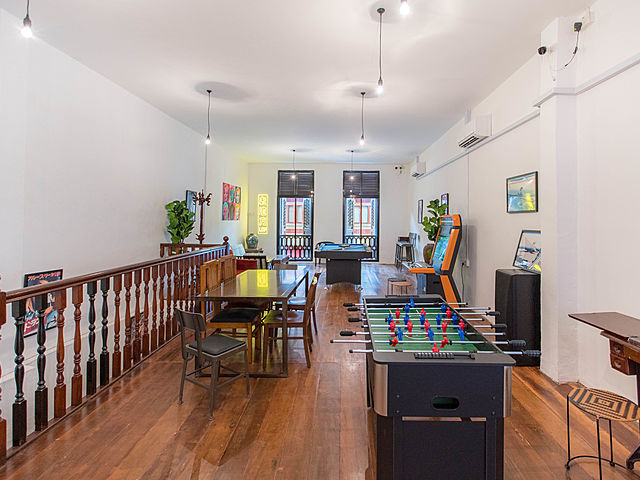 event space with soccer table games and vintage interior