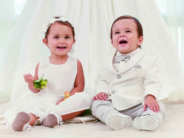 toddlers dressed in wedding outfits