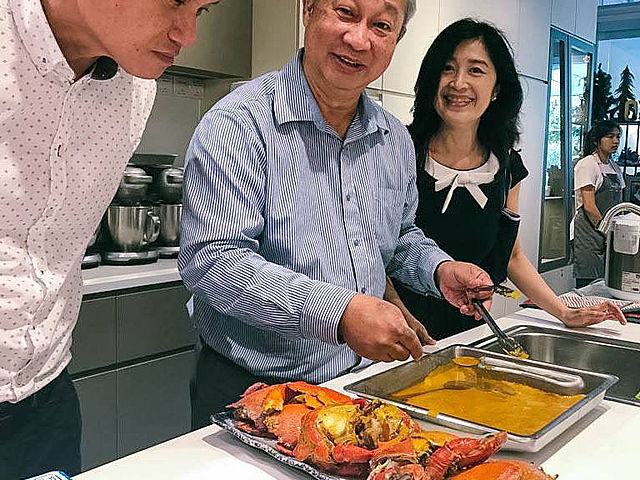 chef showing how to cook a crab