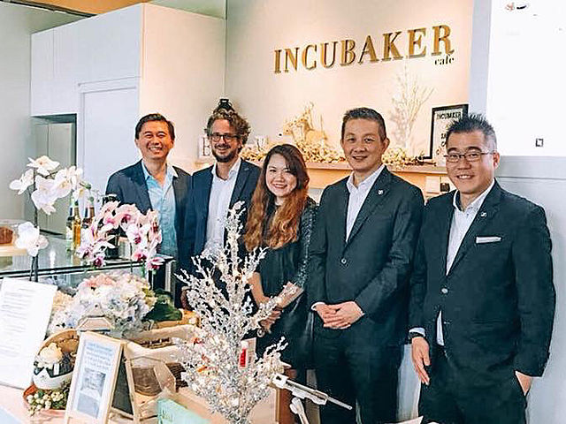 incubaker cafe opening with the team of five people