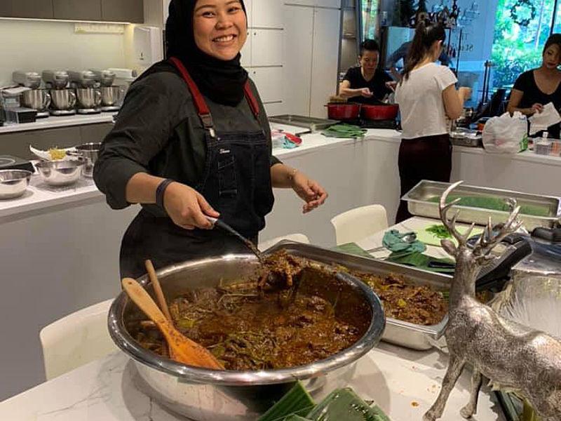 malaysian chef serve a malaysian dish