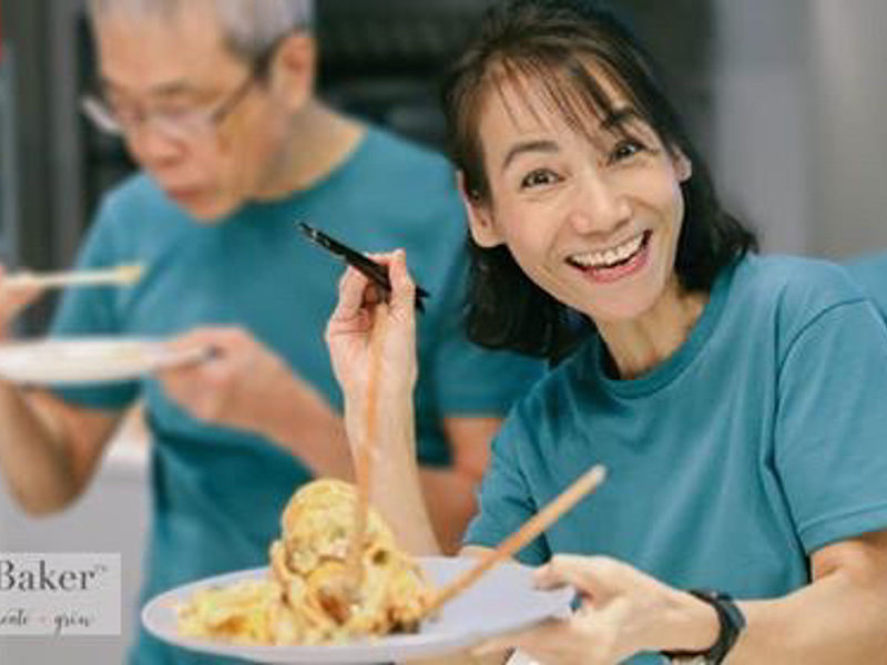 women with green tshirt showing her food creation