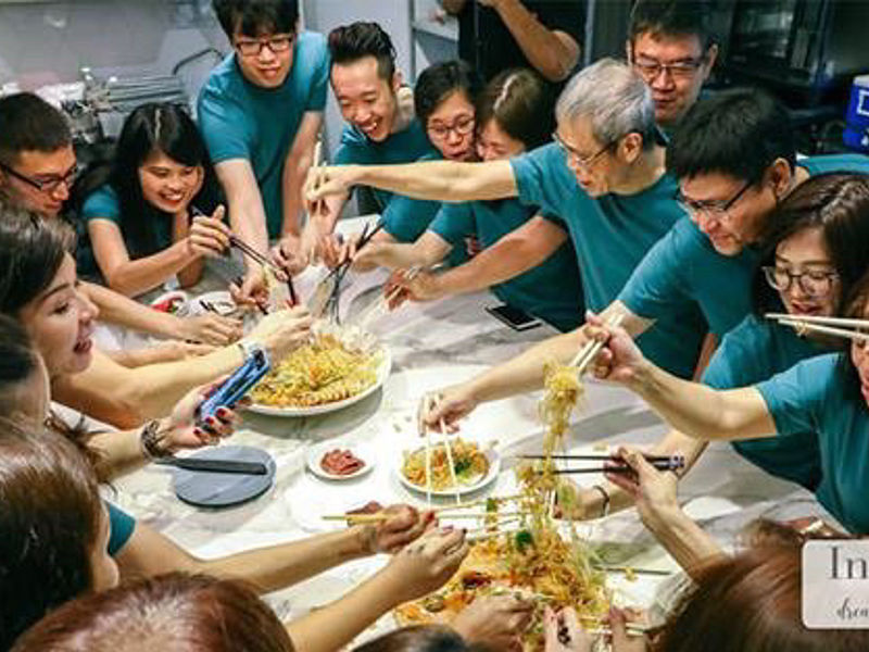 Lo Hei for family's Chinese New Year celebration using green tshirt