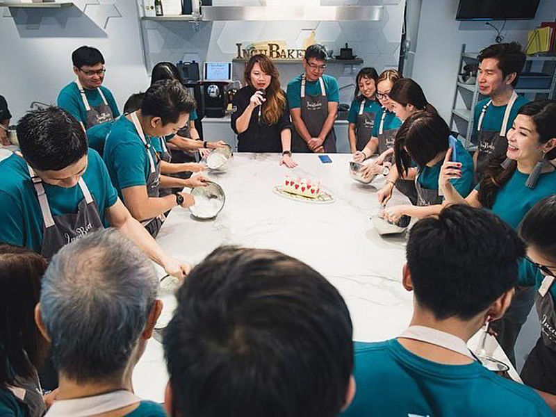 corporate workshop in cooking class with green tshirt