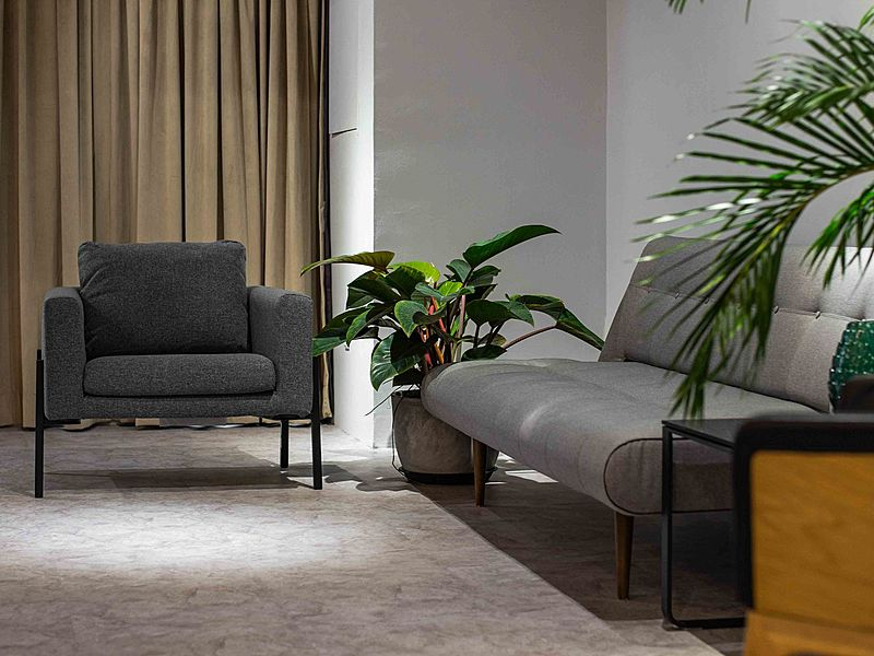 grey couches and plants inside malaysia event space
