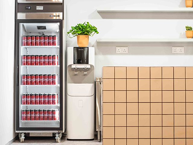 minimalist pantry with beverage cooler and dispenser