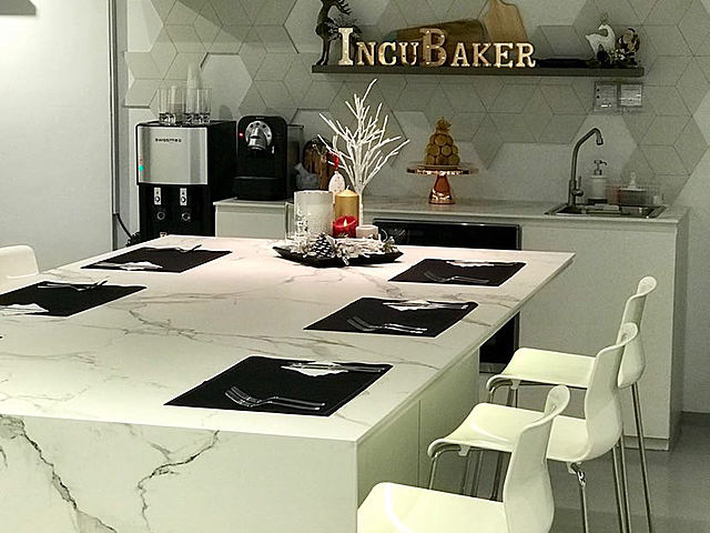 incubaker cafe with table set up for dinner event
