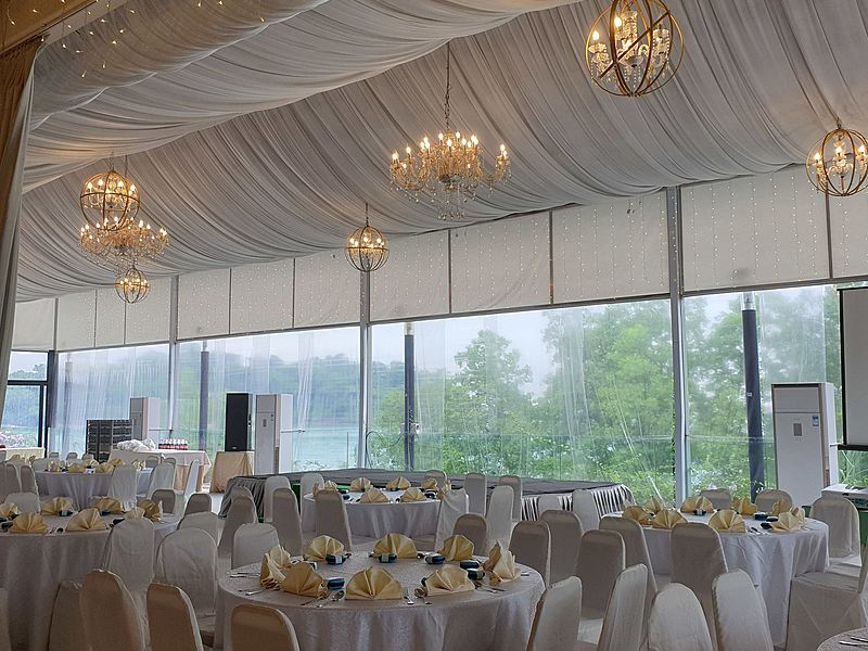 wedding venue with chandelier and floor to ceiling windows