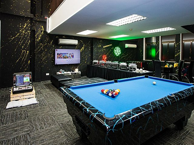 event space for birthday party with black theme and lot of entertainment