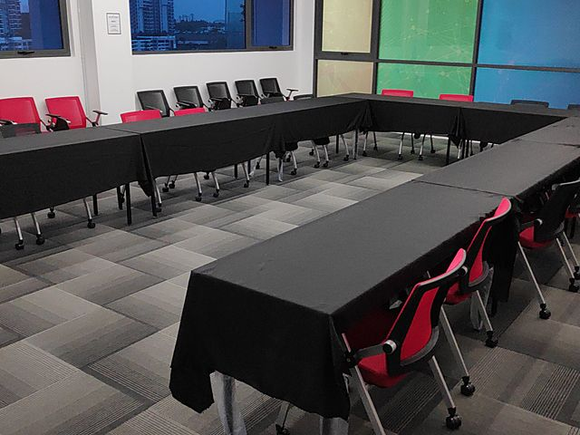 u-shaped meeting space with windows and black table