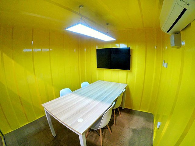 yellow small meeting room in selangor equipped with television