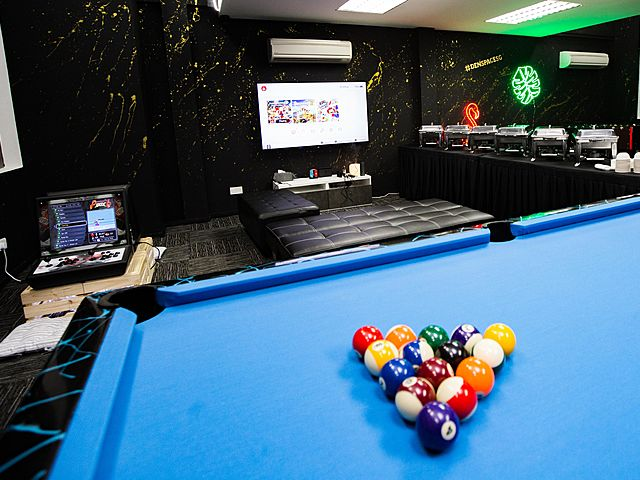 the closer look of billiard table at the center of the venue