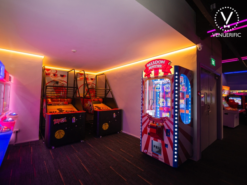 bar with basketball games and grab doll machine