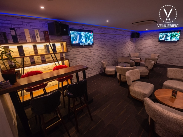 bar with private room with couch and tv