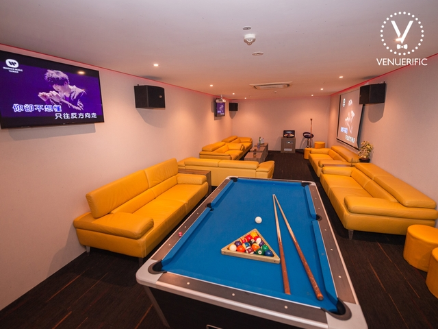 private room with billard table with yellow couch