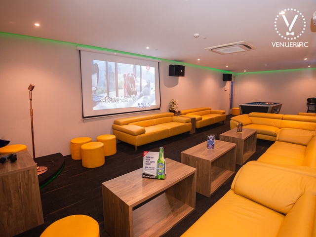 private room with screen projector and yellow couch