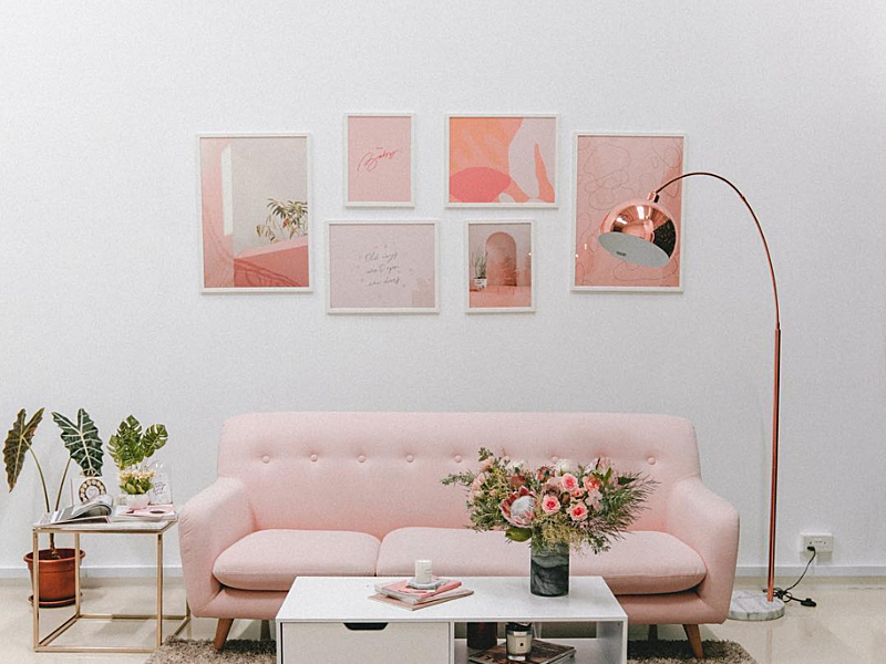 singapore event space equipped with pink long couch and flowers
