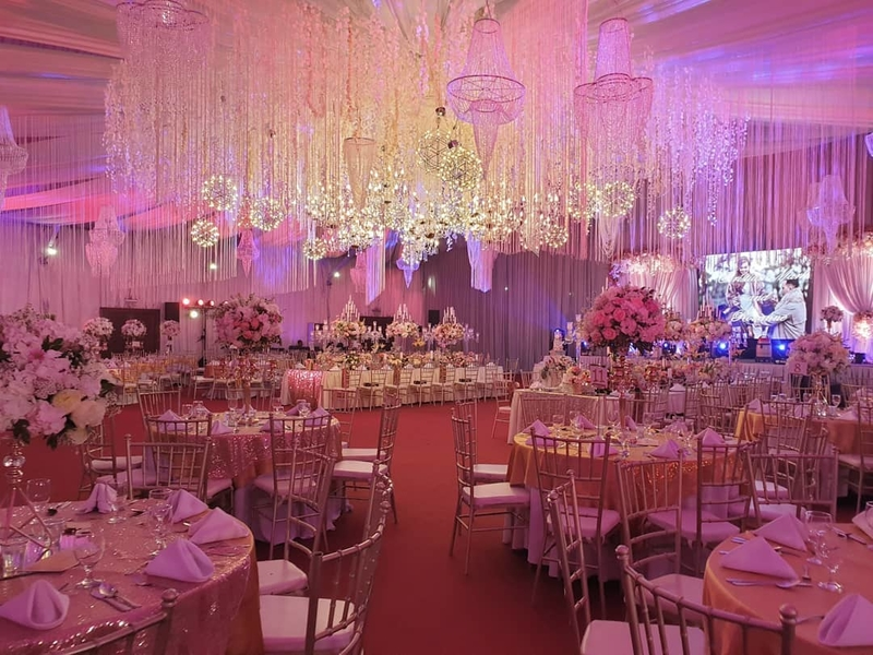 wedding party with pink and purple lighting