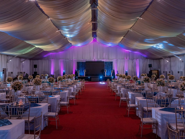 ballroom with high ceiling and red carpet