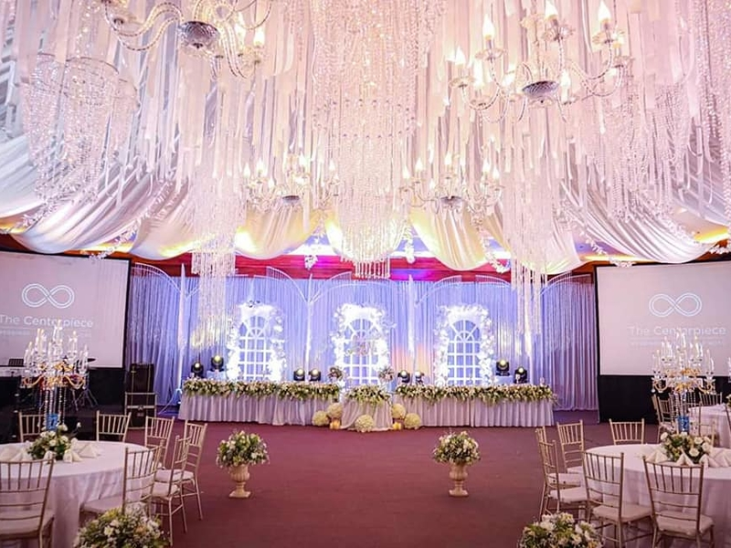 wedding ballroom with grand gleaming chandelier