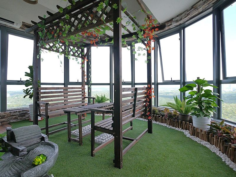 office with green feels and city view