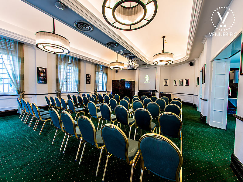 private seminar room with green chairs and a screen