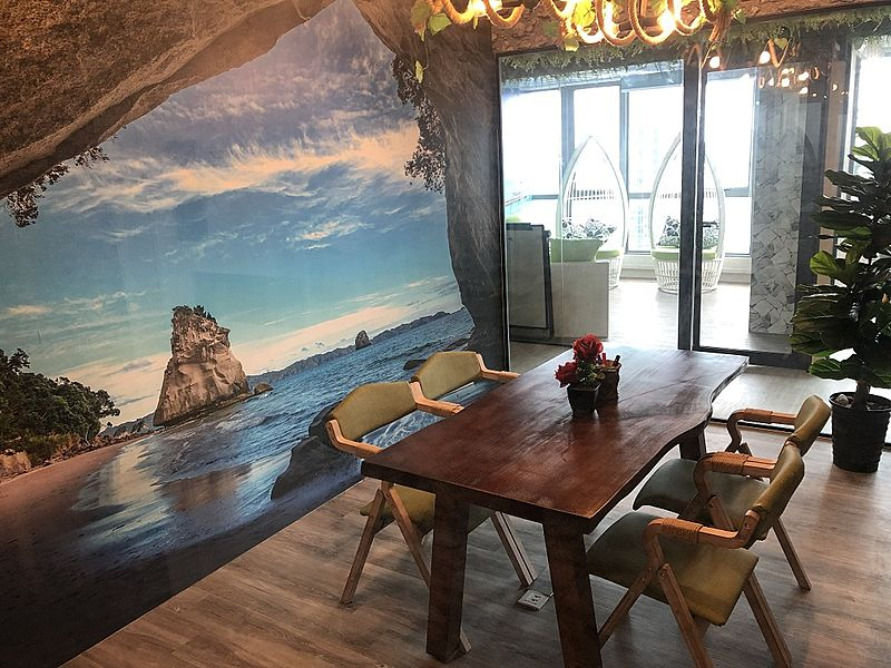 four capacity room with beach wallpaper on wall