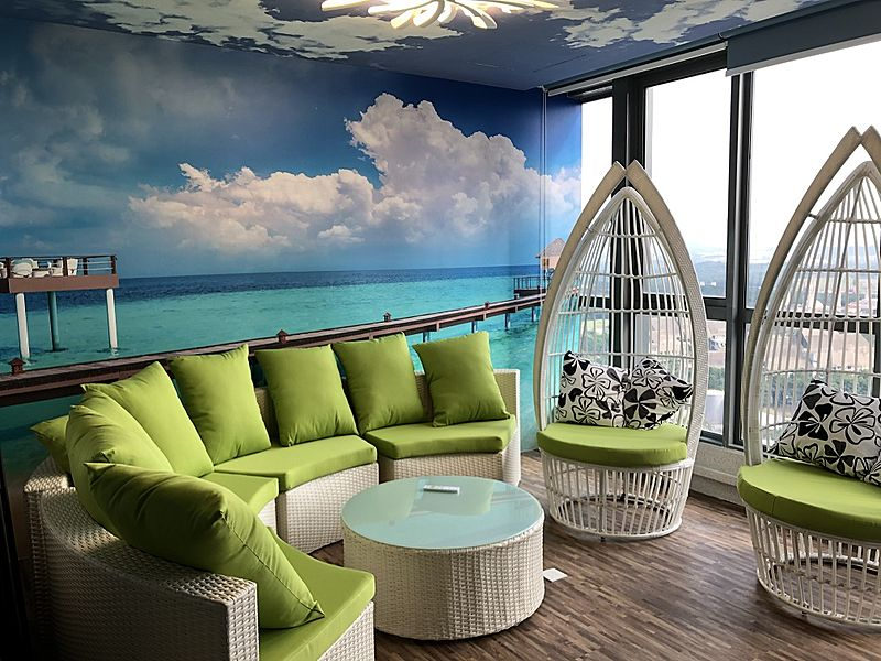 casual meeting room with ocean wallpaper and natural light