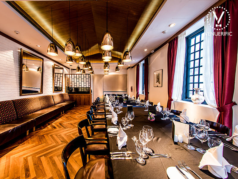 wooden floors fine dining room with black framework windows and long couch