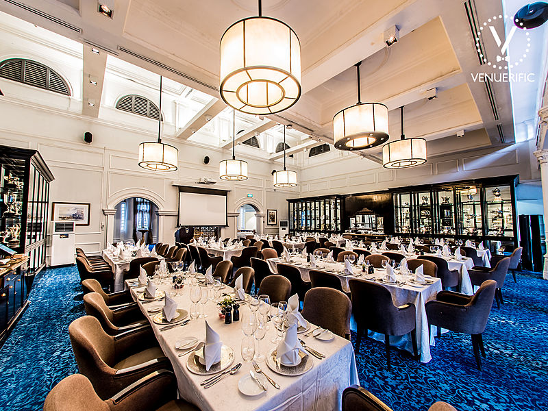 fine dining room equipped with projector screen and blue floors