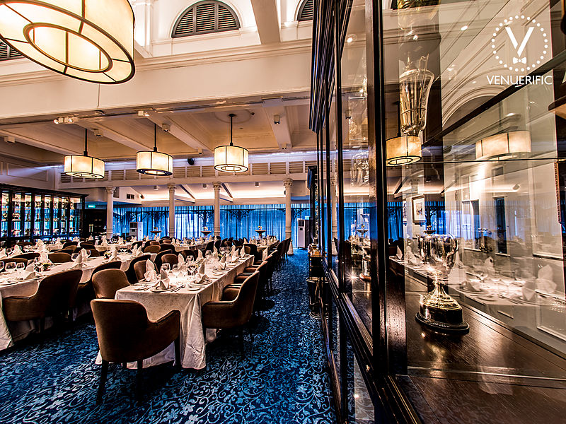 blue floors fine dining room with glass cabinet