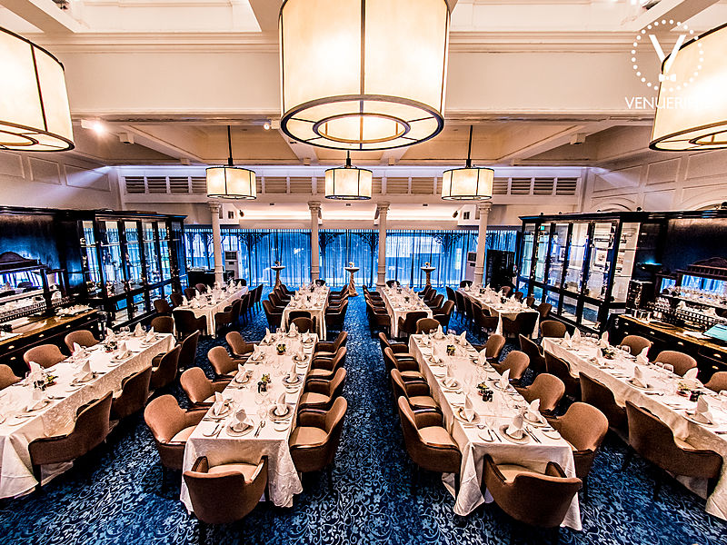 high-ceiling fine dining restaurant with banquet seating