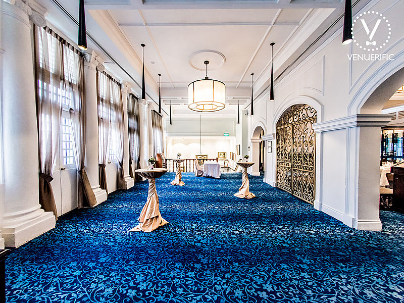 large cocktail event space covered with royal blue carpet
