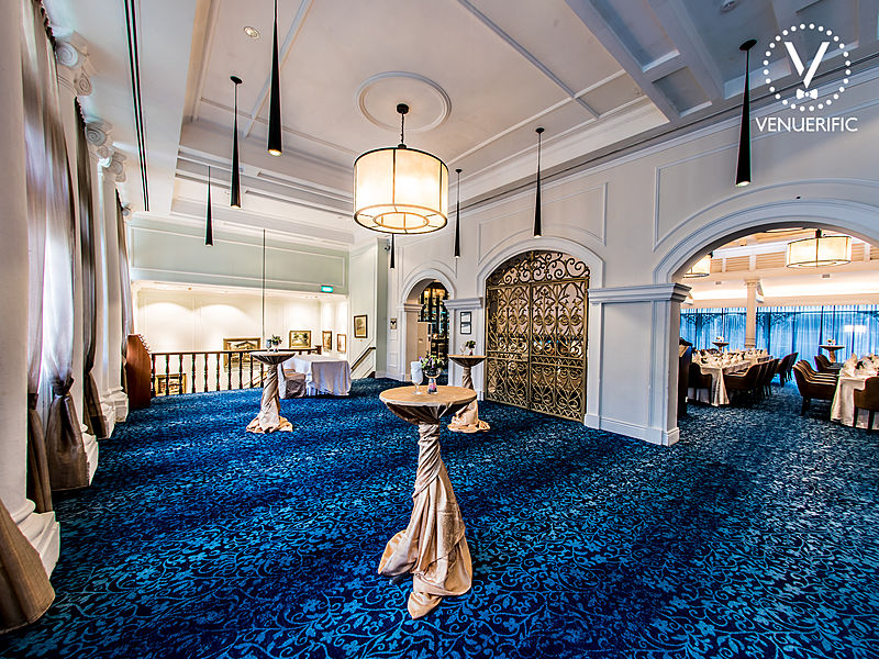 private party venue with royal blue carpet and connecting hallway