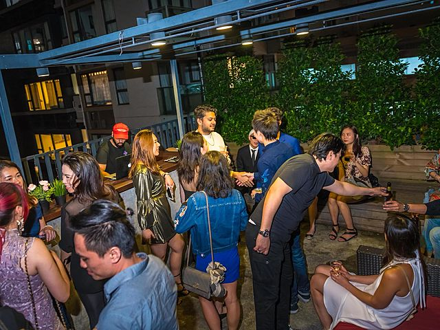 people attending friday night party in hong kong rooftop venue