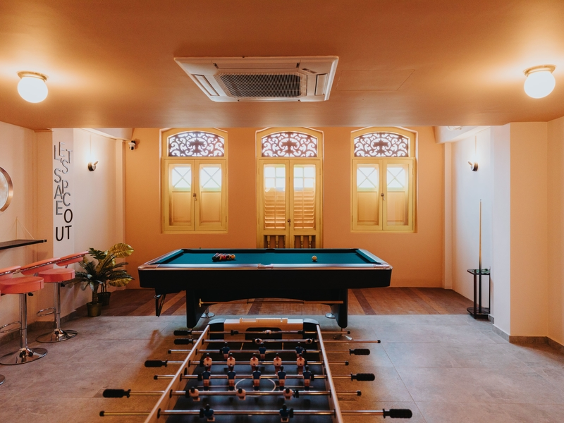 indoor venue with pool table and foosbal
