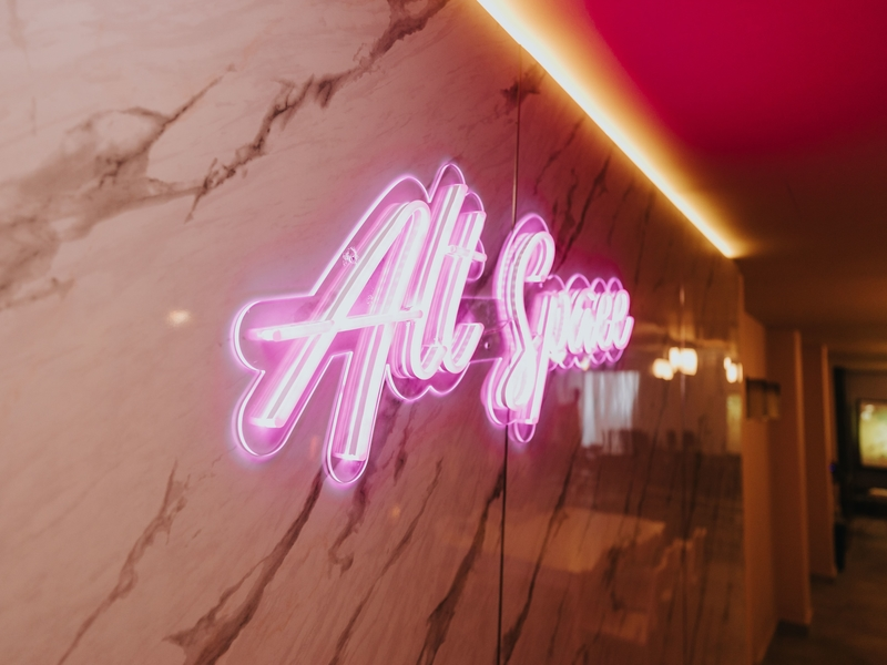 pink neon sign of alternate space by the parallel space