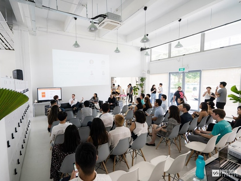 white-themed seminar event space in singapore with projector screen and audience chairs