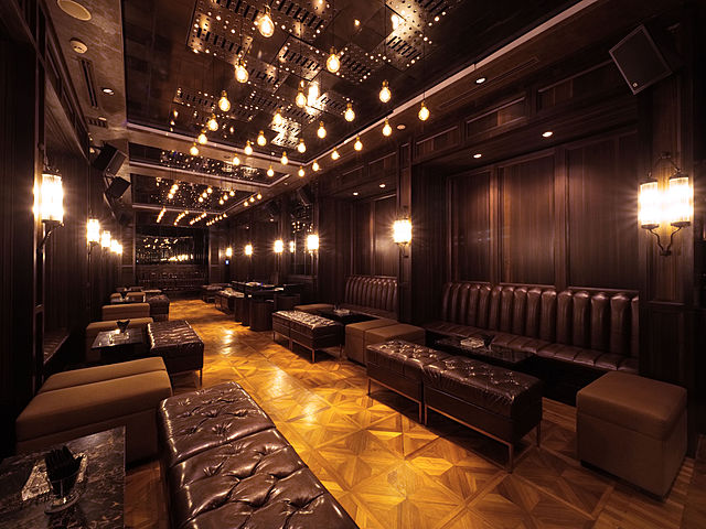 long bar lounge with warm ambience and several couches