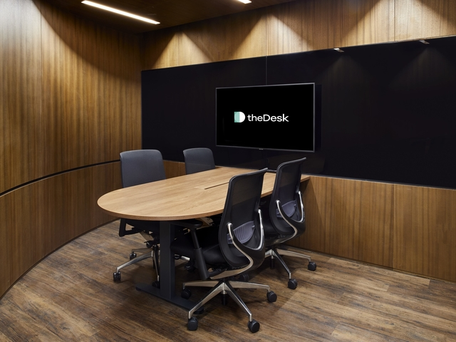 private meeting room with tv screen on the wall