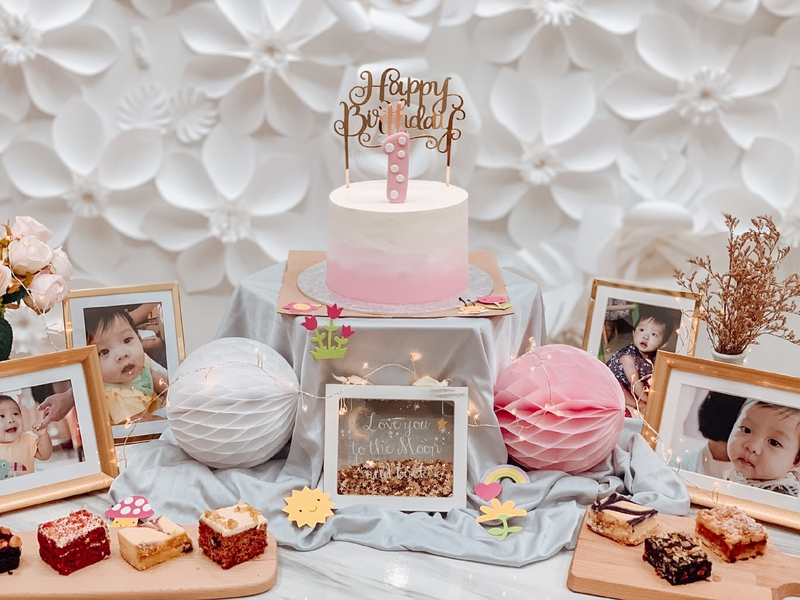 table decorated with photos and cakes for kids birthday party