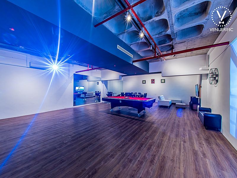 medium scale room with blue lighting and wooden floor