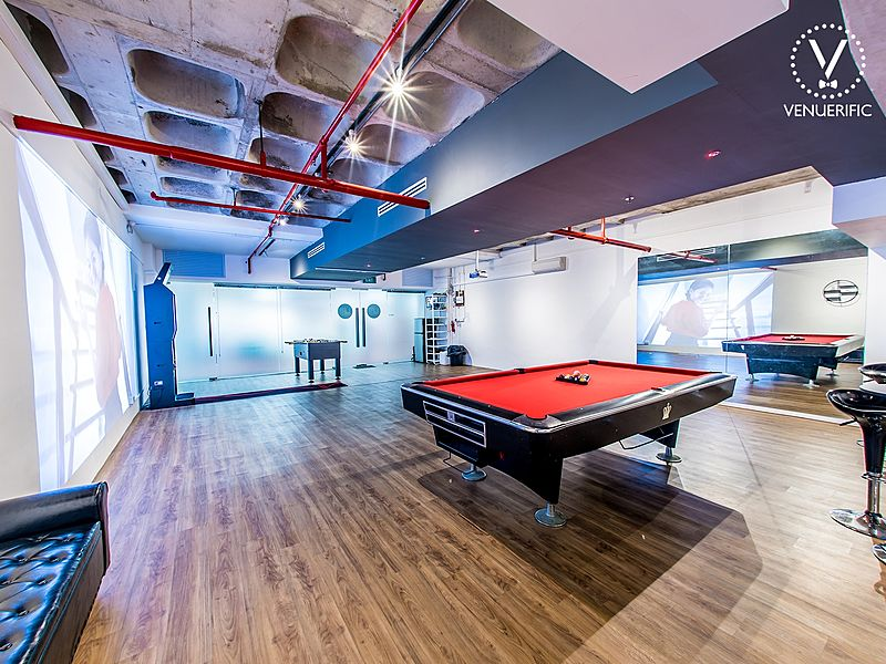 team bonding venue with pool table and wooden floor