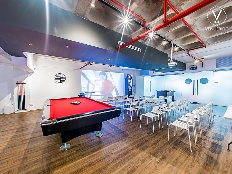 workshop venue with white chairs and pool table