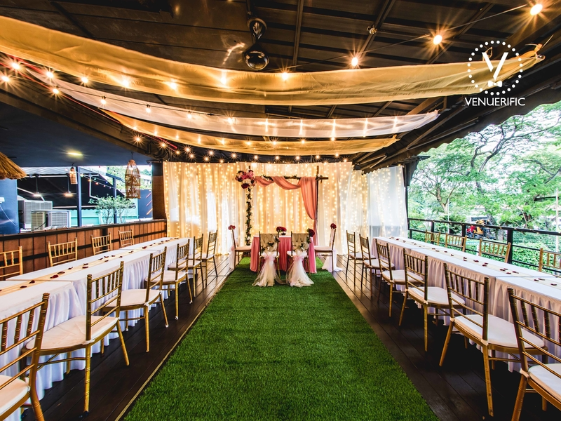 intimate wedding set up with fabric ceiling and wooden chairs